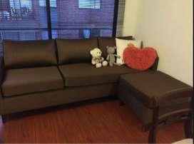 sofa en L con puff adicional