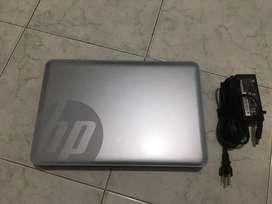 Vendo hermoso portatil gris hp