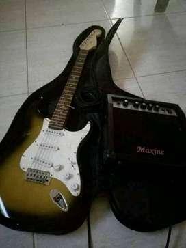Guitarra electrica en perfectas condiciones con su parlante forro semiduro línea y amplificador