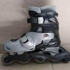 Rollers Action y mochila- Exelente estado