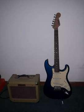Guitarra eléctrica + parlante permuto por guitarra acústica.
