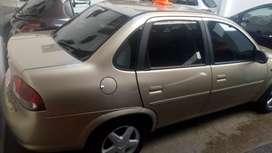 Vendo y financio Chevrolet Corsa dorado