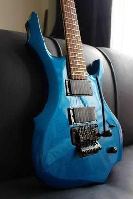 Guitarra Eléctrica JVC con Floyd Rose (con estuche semiduro)