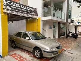 Mazda milenio automatico llegando del interior listo para traspaso y diafrutar cuenta con llantas nurvad caja exelente