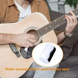 Shaker de guitarra, percusión,