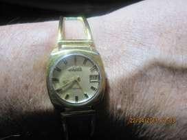 vendo cambio  clasico reloj para dama ., MIDO .,SUIZO ., automático .,