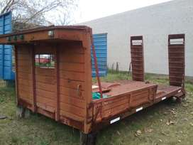 Vendo o permuto carroceria para llevar tractores