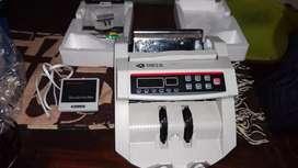 Máquina cuenta billetes