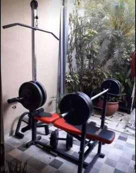 Multigimnasio + barra + pesas