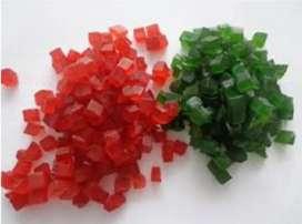 Se vende fruta confitada color verde y roja