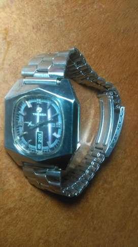 vendo o cambio permuto clasico reloj TRESSA  automatico ., suiso .,