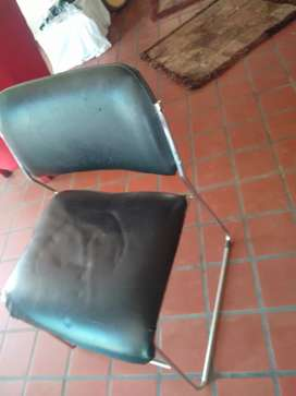 Vendo 4 sillas de cuero y asero