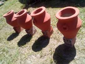 planteras , tinajas grandes en cemento