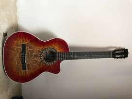 guitarra acustica de color roja con negro