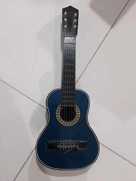Guitarra niño usada