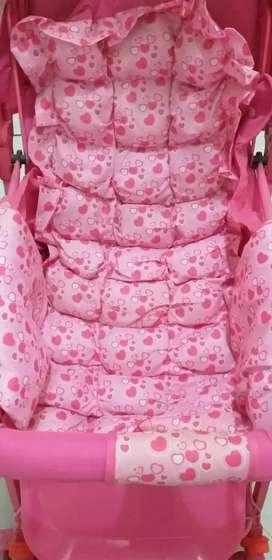 Coche de niña rosado