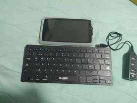 Tablet, teclado, adaptador