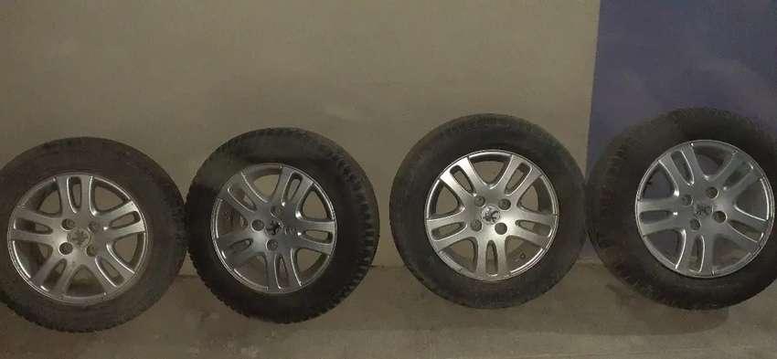 """Vendo 4 llantas Peugeot cotya original 15"""" 4x108 0"""