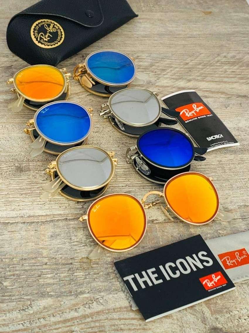 gafas de sol RAYBAN redondas round de colores 0