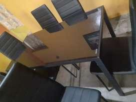 Juego de mesa de vidrio con 6 sillas nuevas