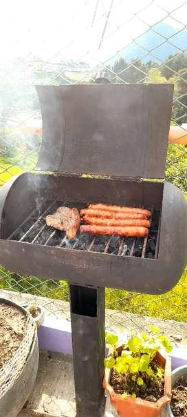 Asador de carnes en cilindro