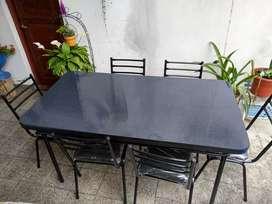 Vendo juego de mesa y sillas nuevo