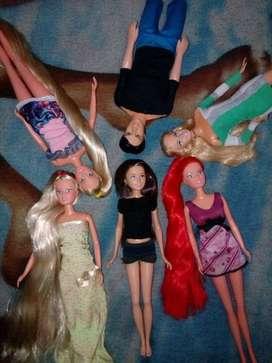muñecas barbie y un carro