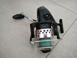 Motor y caña de pesca