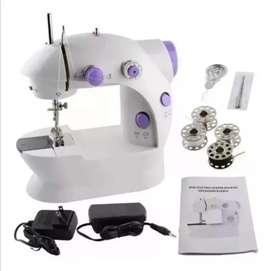 Mini maquina de coser. De uso doméstico