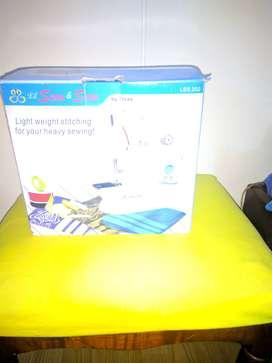 Vendo maquina de coser portátil