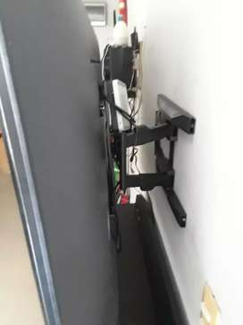 Bases de doble brazo para televisores