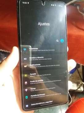 Samsung a51 libre con caja, cargador y funda transparente