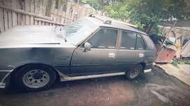 Mazda 323 año del 80.