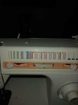 Vendo máquina de coser perfecto estado completa