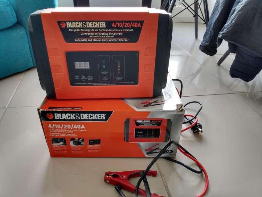 Vendo cargador de batera black and decker 0