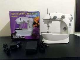 Mini máquina de coser.