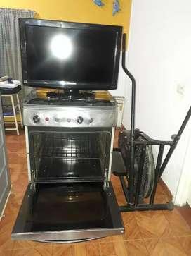 """Vendo estufa con  horno a gas;televisor Panasonic  de 26"""" ; bicicleta elíptica"""