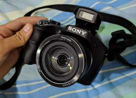 Vendo o cambio Camara Sony DSC-H300 excelente estado, zoom óptico 35X