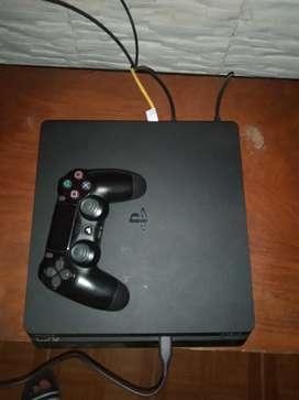 PlayStation 4 de 1 TB y un mando y algunos juegos