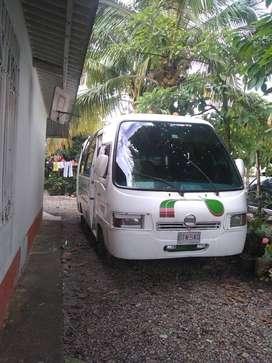 Buseta de 21 pasajeros afiliada a Cootransmeta marca Nissan