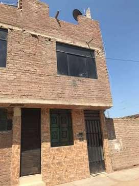 Casa de dos pisos y uno por techar material Noble
