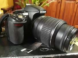 Cámara Nikon D3100 con todos sus accesorios