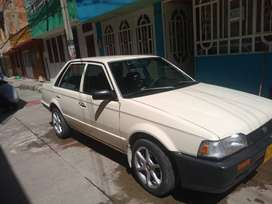 Vendo Mazda 323 NB blanco 88
