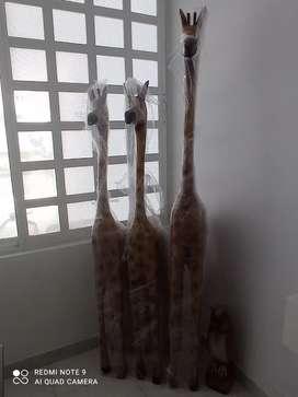 Juego de jirafas en maders