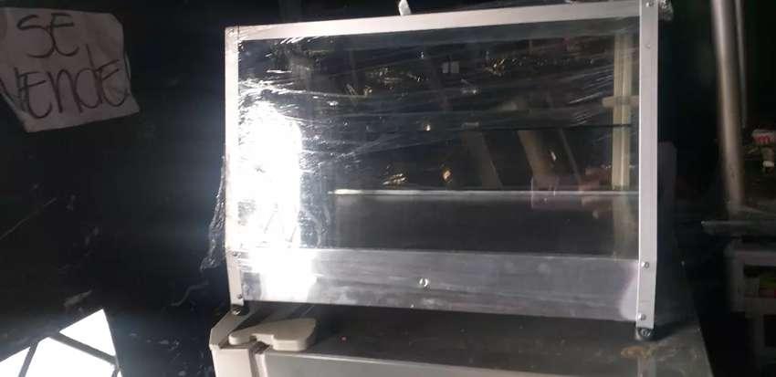 Se vende vitrina de calefacción nueva