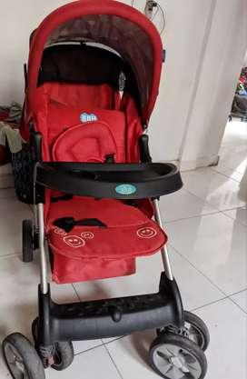 Coche bebé rojo marca BBH