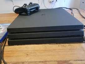 PS4 Pro Usada + joystick + juego