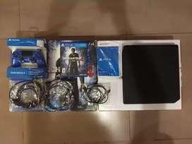 Playstation 4 slim 500gb con 1 joystick y 1 juego