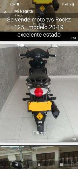 Gangaxo vendo moto roja en buen estado