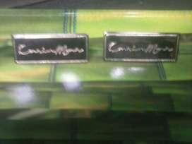 SALDO placa carin,bolsos,morrales,marquilla metálica.carteras,plaquetas